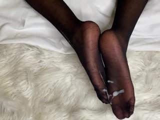 In black stockings cum shot feet...