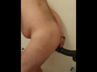 Taking my 8 inch black cock in my ass and loving it