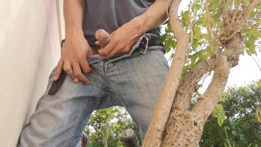 Hiding outside behind a tree to jerkoff with huge cumshot