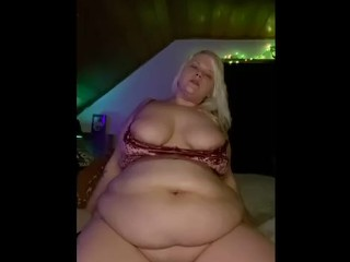 Riding dildo showing belly...