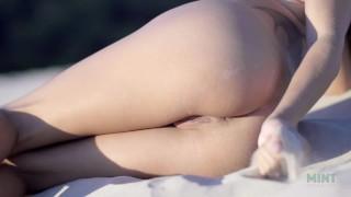 Petite and Beautiful Talia Mint masturbates on Public Beach