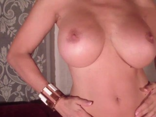With bigboobs in white catsuit gets a big...