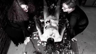 Sensual flower flogging featuring Domina duo