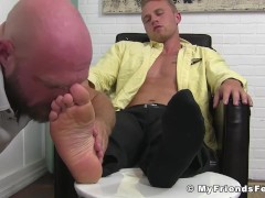 Blonde officer has his feet worshiped by bearded fetish hunk