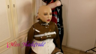 Trailer Miss Maskerade Tied up Enclosed in Condom Hood and Female Silicone Mask, Rubber Doll Blowjob