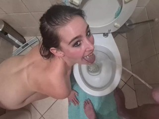 Bitch licking piss stream from her master