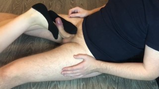 Screen Capture of Video Titled: Teen socks job in black ped socks, cumshot on feet.
