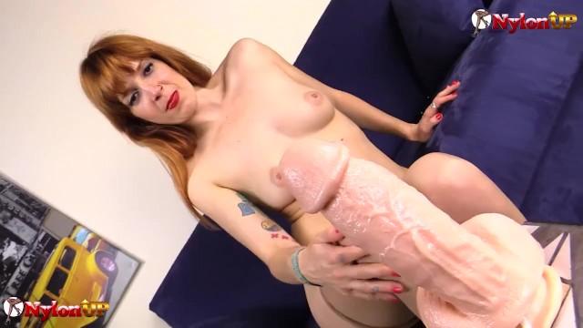 Redhead Irina Vega masturbates and gives footjob in nylons