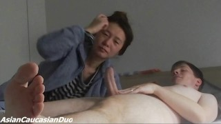 Japanese Wife having fun sucking and strongly squeezing the balls of her white man during Blowjob