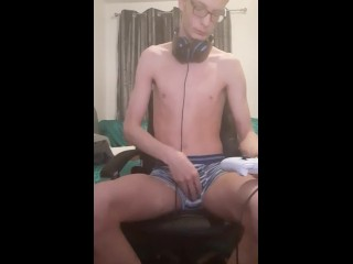 Skinny gamer boy playing with himself while playing video games