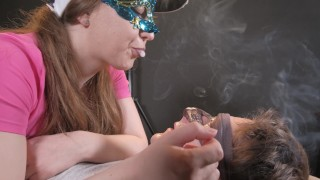 The guy licks the legs. Girl smoke and continue to fill your mouth with saliva, and you must swall