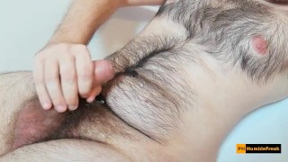 Hairy chest guy with tight foreskin cums on himself after jerking off