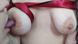 Sucking puffy tied up tits