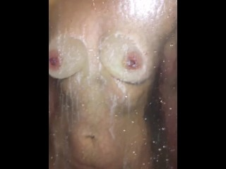 Spying on MILF showering, when she notices, she presses her tits & ass on the glass to tease me.