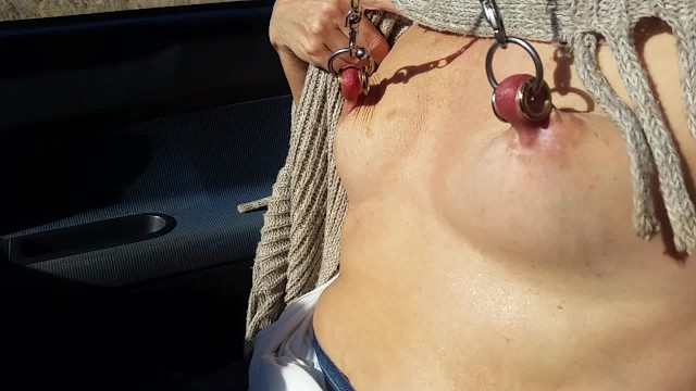 nippleringlover flashing pierced tits with stretched nipple piercings while driving to the beach 17