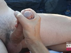 Jerking off on a nudist beach