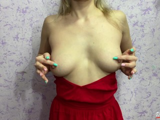 She pulled down the straps of her dress and spanked her tits