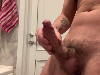 guy jerks off fat cock and cums
