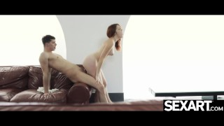 Sexy Spanish redhead rides her man's hard cock so energetically