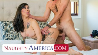 Screen Capture of Video Titled: Naughty America - Tattooed bombshell, Lily Lane, demands sex from her husband's friend before sendin