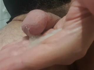 Tranny enjoying cumshot right in her hand...