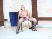Sexy shemale with big booty masturbates on the chair at casting Aimee Lee