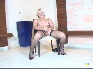 Sexy shemale with big booty masturbates on the chair at casting