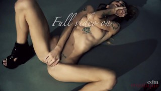 Adelle Unicorn is masturbating with her Kiiroo vibrator on a comfy chair
