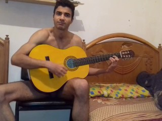 Sexy and guy training playing guitar after kissing...