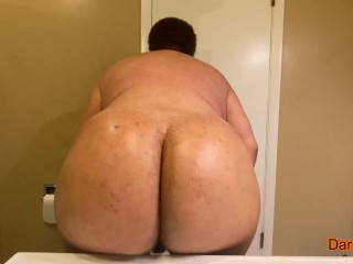 Fat man oiling up ass then shaking it...