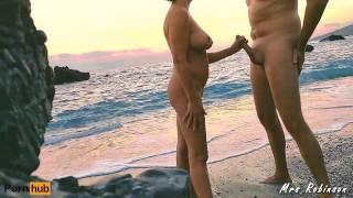 Handjob and Masturbating to eachother on Public Beach