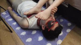 Russian mistress dominates slave. He licks her feet