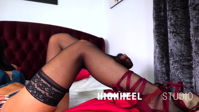 SEXY BRUNETTE TAKES OFF HER BLACK NYLON STOCKINGS AND SEXY HIGH HEELS 14