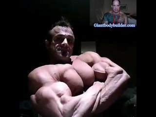 Supergiant bodybuilder posing on camera...