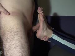 Neighbor's soles get a massive spraying (footjob)