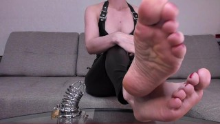 Feet and a chastity cage for a beta loser