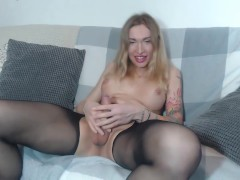 Russian shemale Eva Lynx cummed on belly after jerking off in sexy pantyhose