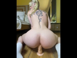 Tattooed blonde ts with bouncy riding big dildo...