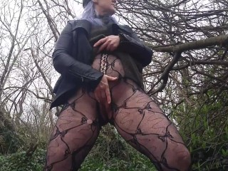 blue haired Milf in ripped fishnets pissing and mastrubating on public trail