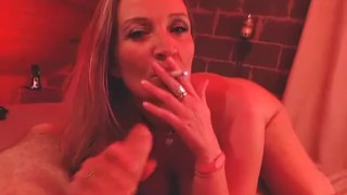 MILF smoking a cigarette while getting fucked by hubby