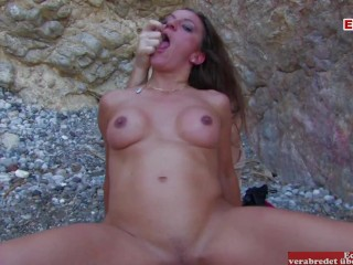 Hot brunette woman with awesome tits does outside...