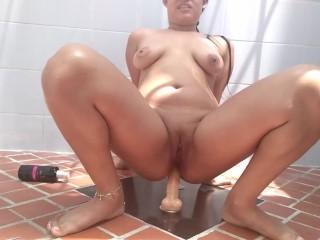 Latina slut playing toy backyard trying to open...