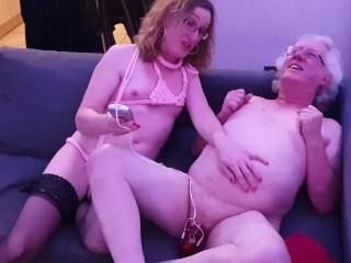 Lisa electro shocks John's cock in E-stim chastity cage