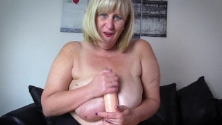 Big Tit Stepmom practices her oily hand job technique
