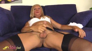 Transvestite Claudia stroking her cock in stockings