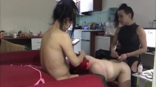 Two asian Ladyboys and one masked faggot with pink mask getting fucked and sucking cock