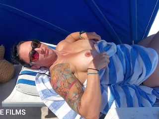 Milf teasing beach flashing her titites...