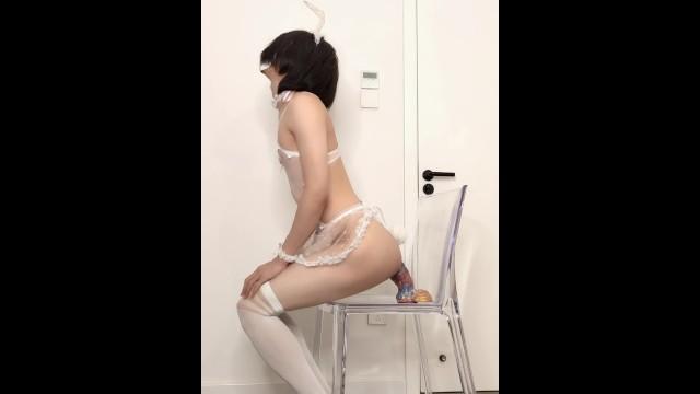 Depraved crossdressing maid anal masturbates using a huge dildo and a fist dildo till cums