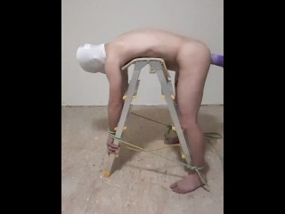 Mistress fisting sub tied to a ladder...