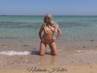 Wife in yellow bikini on nude beach